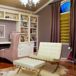Medium sized contemporary study in St Louis with purple walls, dark hardwood flooring, a built-in desk and brown floors.