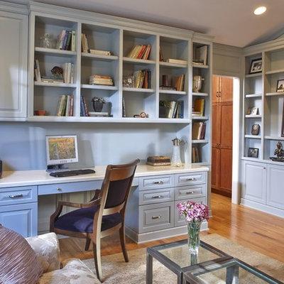 Mid-sized elegant built-in desk medium tone wood floor study room photo in San Francisco with blue walls