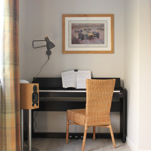 Inspiration for a medium sized contemporary home office in West Midlands with grey walls, laminate floors and beige floors.