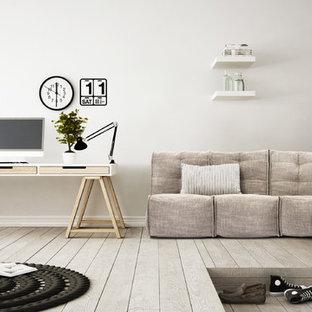 シドニーの中サイズのモダンスタイルのおしゃれな書斎 (白い壁、ラミネートの床、暖炉なし、漆喰の暖炉まわり、自立型机、グレーの床) の写真