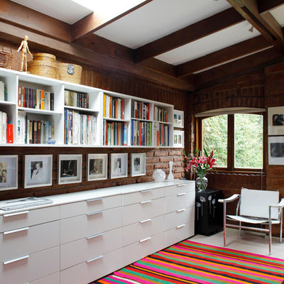 Example of a trendy freestanding desk home office design in Other