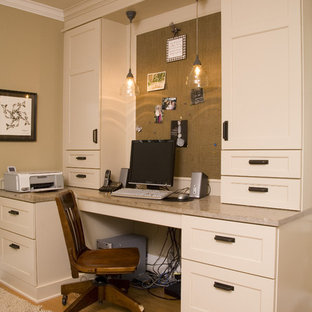 Home office - traditional built-in desk home office idea in Seattle