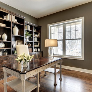 Example of a transitional home office design in Minneapolis