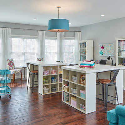 Example of a large classic freestanding desk medium tone wood floor craft room design in Baltimore with gray walls