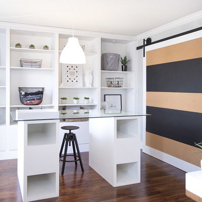 Home office - contemporary freestanding desk dark wood floor home office idea in Toronto with gray walls