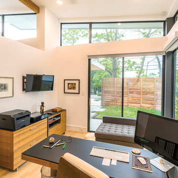 Home office has excellent views to the outside thanks to the sliding glass door