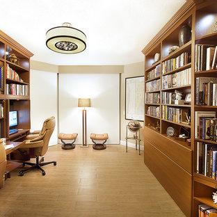 Study room - small contemporary built-in desk ceramic tile study room idea in Miami