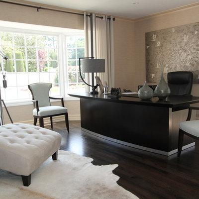 Example of a trendy freestanding desk dark wood floor home office design in San Francisco with beige walls