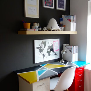 Home office - small contemporary freestanding desk carpeted home office idea in Other with black walls