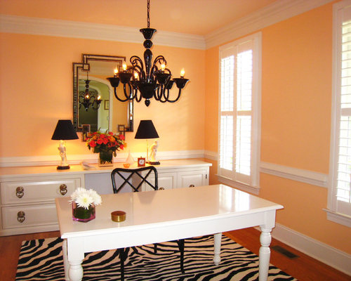 Transitional Dark Wood Floor Home Office Photo In Miami With Orange Walls And A Freestanding Desk