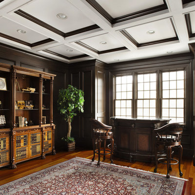 Home office - traditional medium tone wood floor home office idea in New York