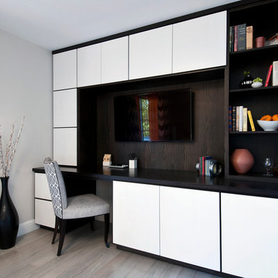 Inspiration for a mid-sized contemporary built-in desk light wood floor study room remodel in San Francisco with gray walls and no fireplace