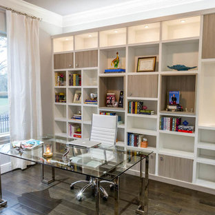 Mid-sized trendy freestanding desk dark wood floor study room photo in Los Angeles with white walls