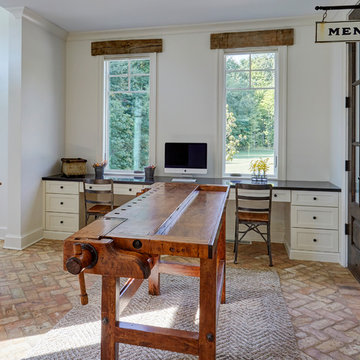Home Office with Built-In Desks, Brick Floors, and Antique Workbench