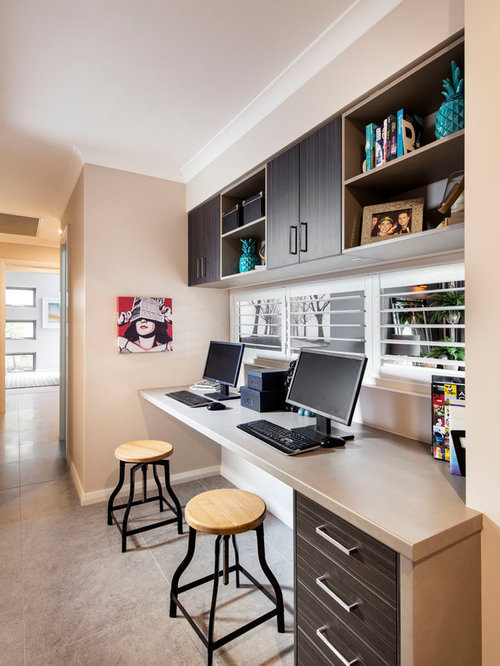 Small Trendy Built In Desk Gray Floor Study Room Photo In Perth With Beige  Walls
