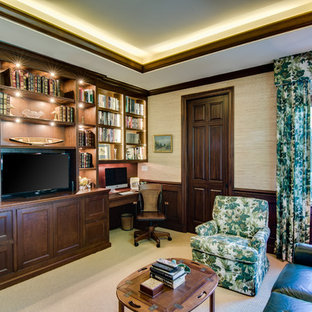Home office - built-in desk carpeted home office idea in Miami with no fireplace