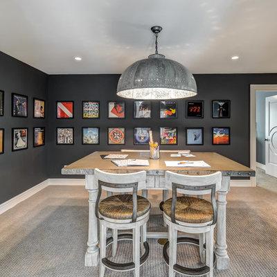 Example of a huge urban freestanding desk carpeted and beige floor home studio design in Cincinnati with black walls and no fireplace