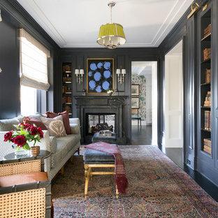 シカゴの広いトランジショナルスタイルのおしゃれなホームオフィス・書斎 (ライブラリー、青い壁、濃色無垢フローリング、標準型暖炉、漆喰の暖炉まわり、茶色い床) の写真