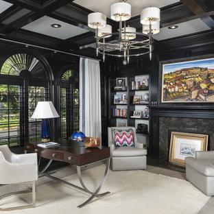 タンパのトランジショナルスタイルのおしゃれなホームオフィス・書斎 (黒い壁、濃色無垢フローリング、標準型暖炉、自立型机、茶色い床) の写真
