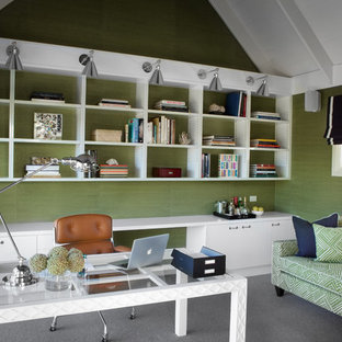 Elegant freestanding desk carpeted home office photo in Melbourne with green walls