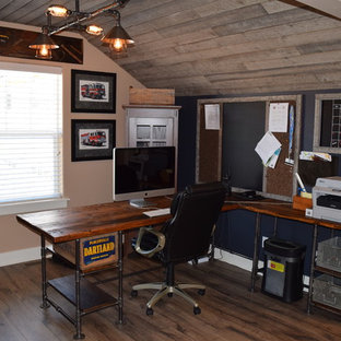 Small urban freestanding desk dark wood floor study room photo in Denver with blue walls