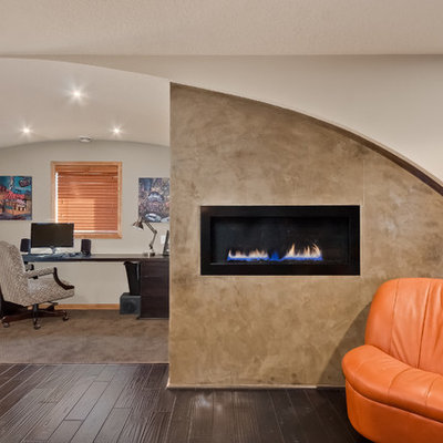 Mid-sized trendy freestanding desk dark wood floor and brown floor study room photo in Minneapolis with white walls, a ribbon fireplace and a concrete fireplace