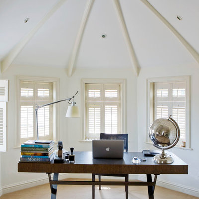 Inspiration for a timeless freestanding desk carpeted home office remodel in Other with white walls