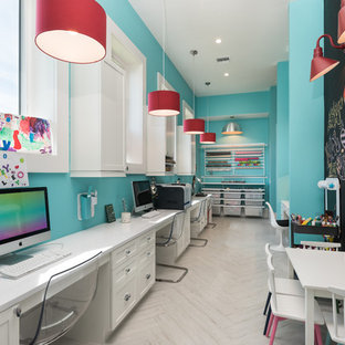 Example of a transitional painted wood floor and white floor home office design in Orlando with blue walls