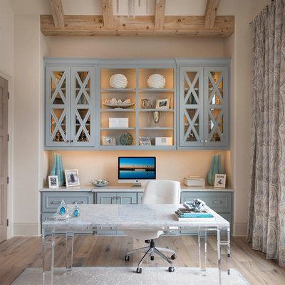Study room - coastal freestanding desk light wood floor and beige floor study room idea in Dallas with beige walls
