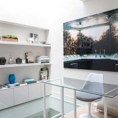 Inspiration for a contemporary freestanding desk study room remodel in London with white walls