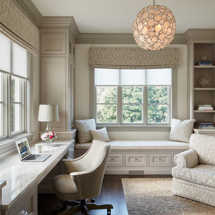 Study room - traditional built-in desk dark wood floor study room idea in Chicago with white walls and no fireplace