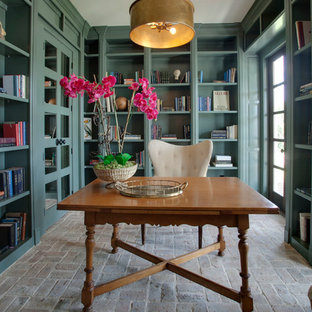 Mid-sized tuscan freestanding desk brick floor study room photo in Dallas with green walls