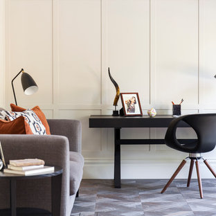 Study room - contemporary freestanding desk study room idea in London with white walls