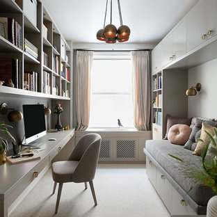 Small trendy built-in desk carpeted study room photo in New York with white walls and no fireplace