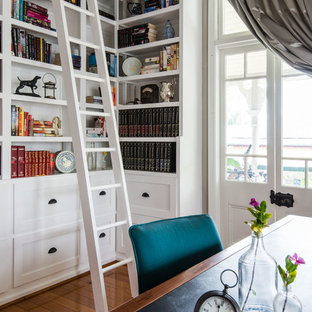 Inspiration for a traditional home office in Brisbane with a library, medium hardwood floors and a freestanding desk.