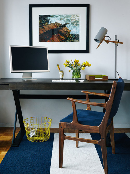 inspiration for a midcentury modern freestanding desk home office remodel in new york with white walls