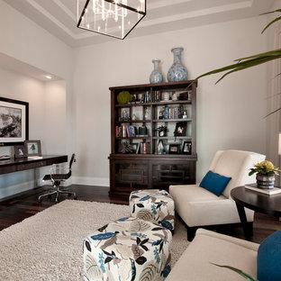Example of a trendy freestanding desk dark wood floor home office design in Tampa with gray walls