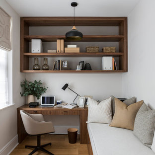 Inspiration for a traditional study in London with white walls, medium hardwood flooring, no fireplace and a freestanding desk.