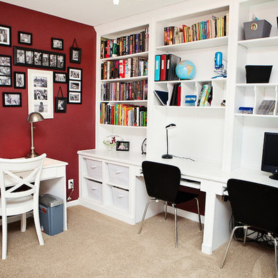 Inspiration for a mid-sized transitional built-in desk carpeted and brown floor home office remodel in Raleigh with red walls and no fireplace