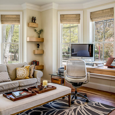 Inspiration for a large transitional freestanding desk medium tone wood floor and brown floor study room remodel in Boston with beige walls and no fireplace