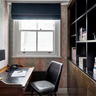 Design ideas for a small vintage home office and library in London.