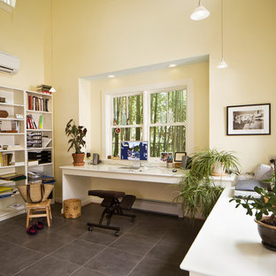 Home office - mid-sized traditional built-in desk porcelain tile and gray floor home office idea in DC Metro with yellow walls and no fireplace