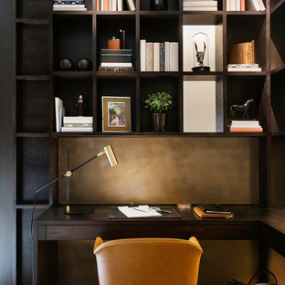 Photo of a small contemporary home office and library in London with white walls, a built-in desk and beige floors.