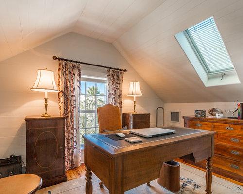 traditional freestanding desk medium tone wood floor and orange floor study room idea in miami with