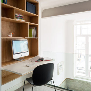 Photo of a contemporary home office and library in London.