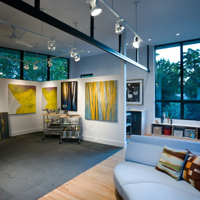 Inspiration for a contemporary medium tone wood floor home studio remodel in Dallas with white walls