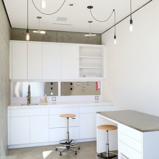 Inspiration for a mid-sized contemporary built-in desk concrete floor and gray floor home studio remodel in Orange County with white walls and no fireplace