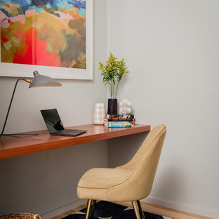 Small Office Room. Example Of A Small Coastal Built In Desk Light Wood Floor