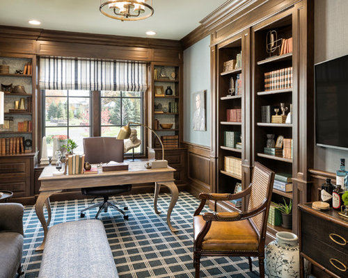 elegant freestanding desk carpeted and multicolored floor home office library photo in minneapolis