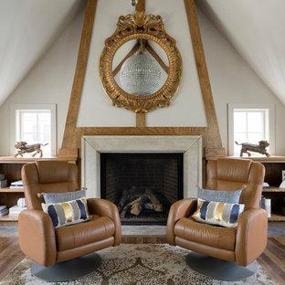 Immagine di uno studio country con pareti bianche, pavimento in legno massello medio, camino classico e pavimento marrone